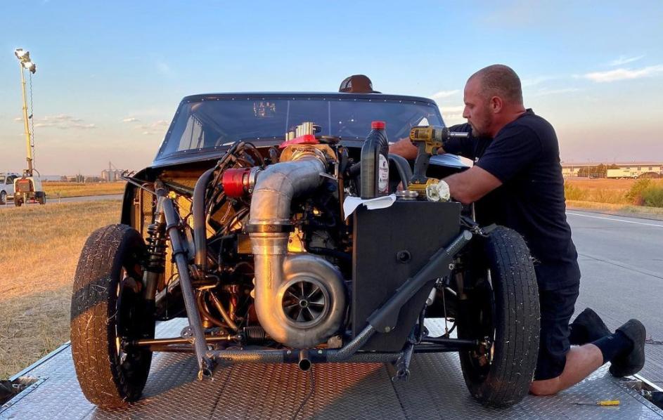 Larry Axman Roach working on car