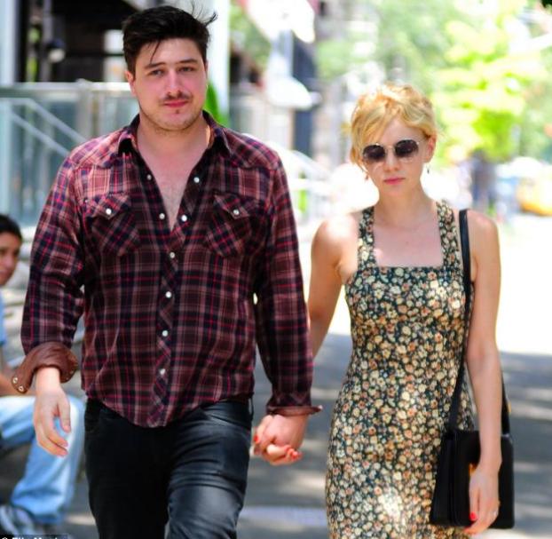 Marcus Mumford with his wife, Carey Mulligan
