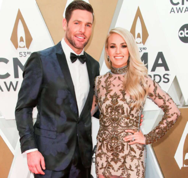 Mike Fisher with his wife, Carrie Underwood