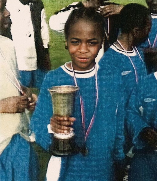 Childhood Picture of Raheem Sterling Holding Trophy