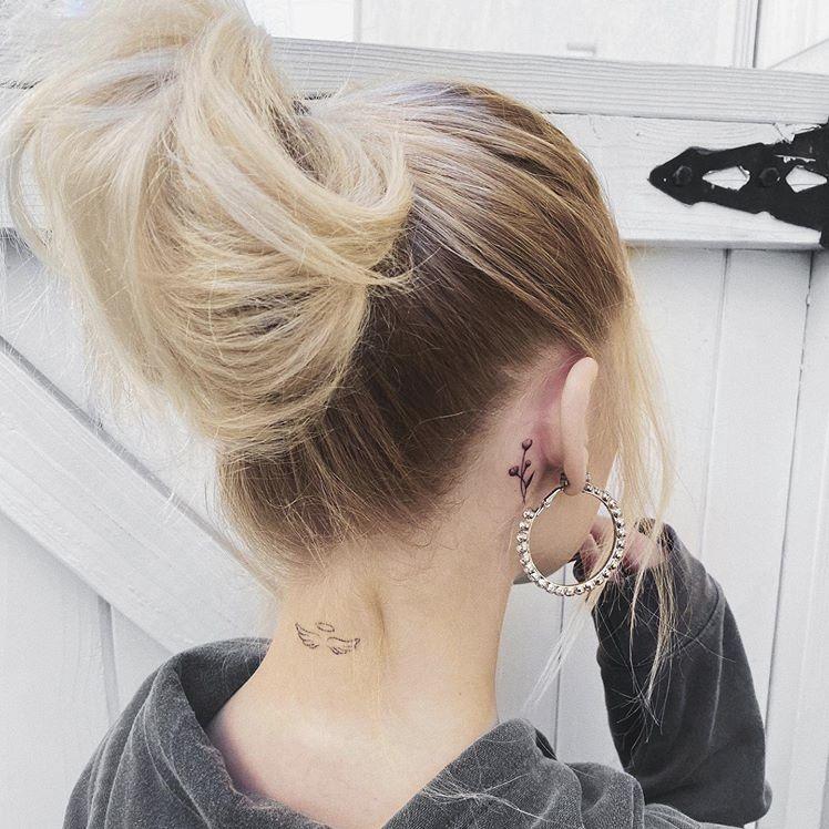 Loren has Angel Wings tattoo