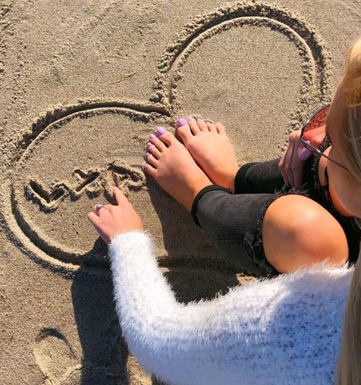 love in the air and toes in the sand