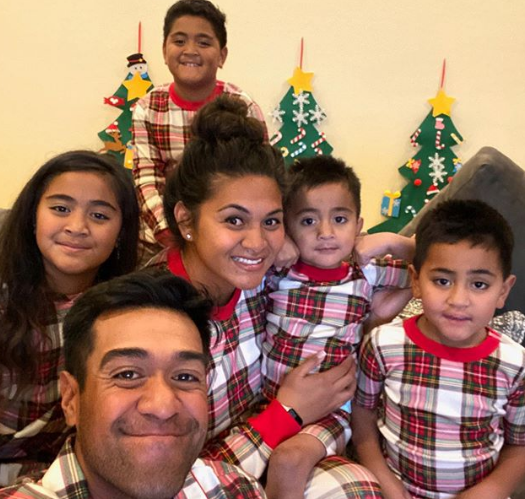 Tony Finau With His Wife And Child