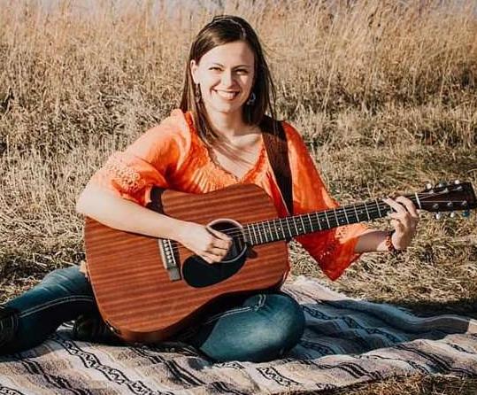 Lindsey Playing a Guitar