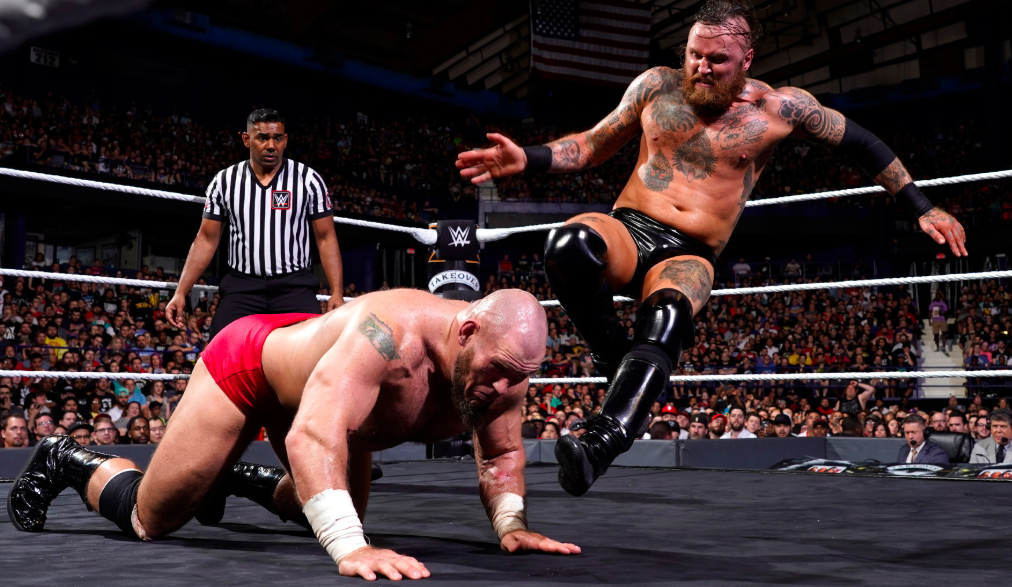 Aleister Black fighting against the opponent