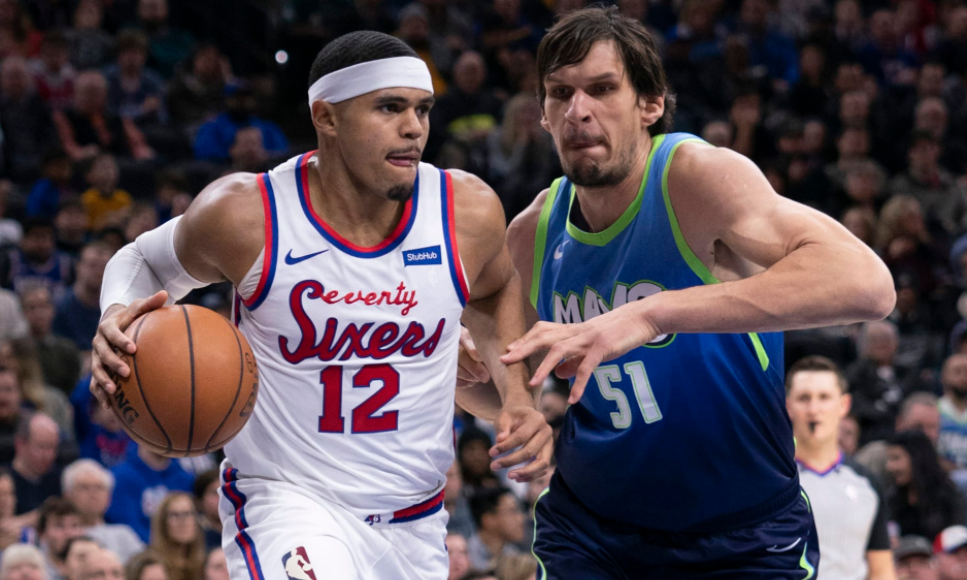 Tobias Harris (left), heading the ball against the oppoenent