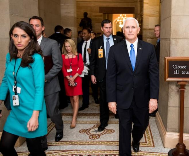 Alyssa Farah (left) walking alongside Vice President Mike Pence (right)