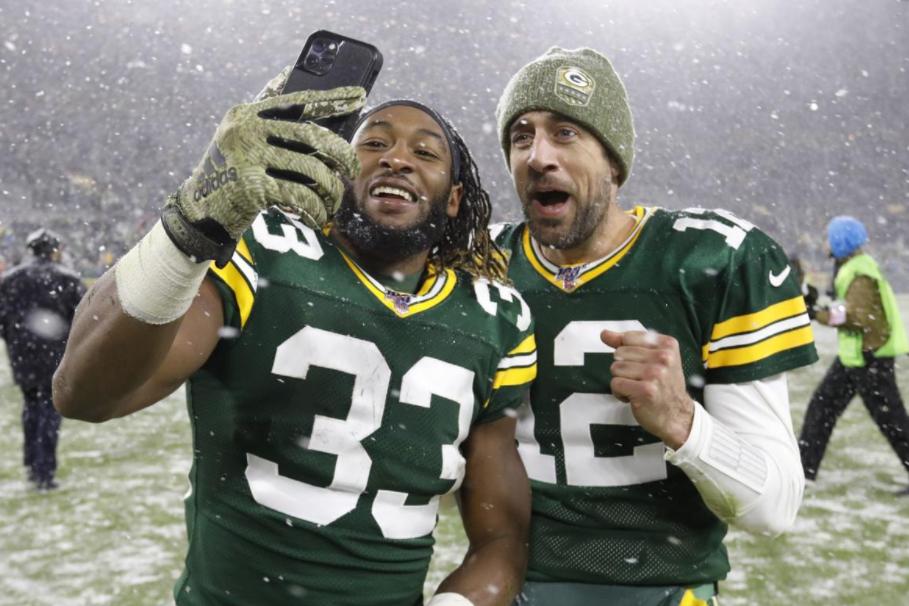 Aaron Jones and Aaron Rodgers taking a selfie