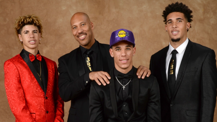 LaMelo Ball, LaVar Ball and LiAngelo Ball pose for a portrait with Lonzo Ball during the 2017 NBA draft in New York.