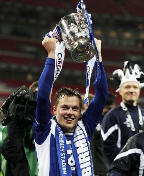 Sebastian Larsson Holding The Trophy