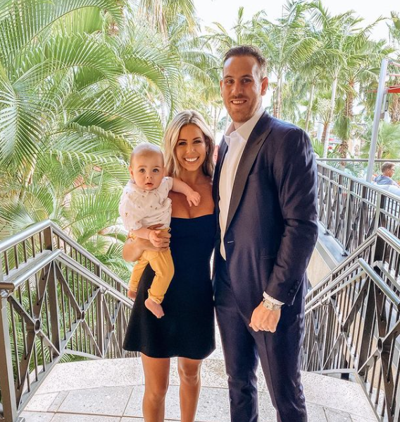Jimmy Hayes with his wife and their kid