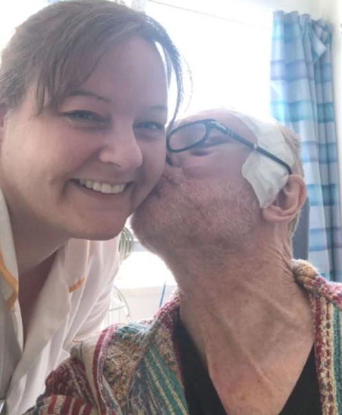 Brian Travers with his nurse after the tumour surgery